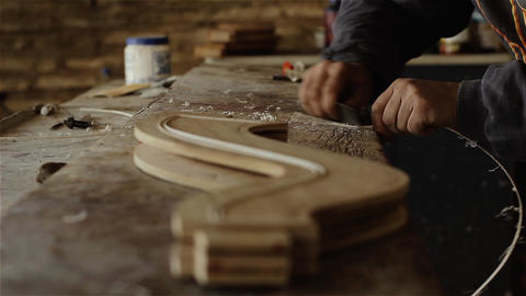 Artisan Building A Wooden Musical Instrument GIF