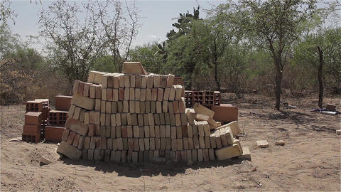 Bricks On The Farm Next To A Wire Fence Footage