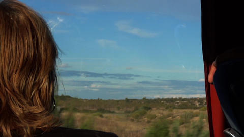 She looks nostalgically out the window of the bus landscape that I traveled on f Footage
