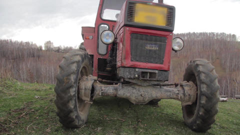 Tractor driver who goes into the woods to drag logs to prepare it for winter 43 Footage