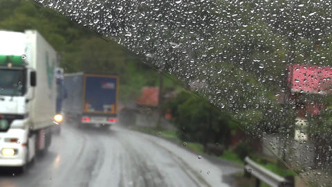 Trip taken with a bus on the way drenched, seen through the windshield of the dr Footage