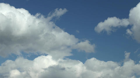 Cumulus clouds in blue sky time lapse Footage