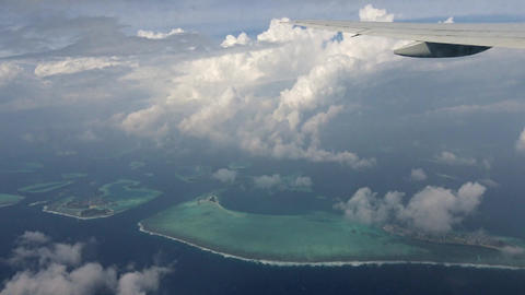 Flight of the airliner over the Indian ocean and the Maldives Footage