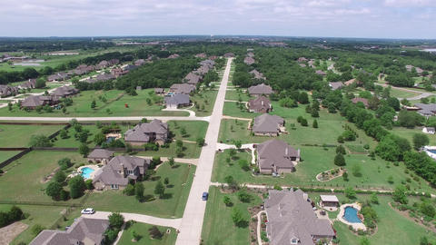 Aerial flight over a neighborhood in Double Oak Texas Live Action
