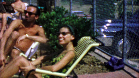 1963: Cute 60's girl poolside sunbathing on chaise lounge chair Footage