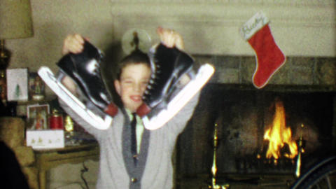 1963: Boy gets black winter ice skates for holiday Christmas gift Footage