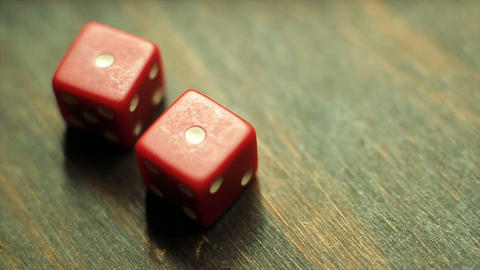 Two Red Dice Roll A Pair Of Ones stock footage