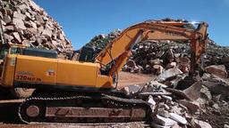 excavator working on marble stone quarry Footage