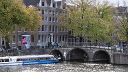 tourists boat going through canal in Amsterdam Footage