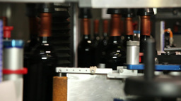 wine bottles in the bottling line conveyor belt, slider shot Footage