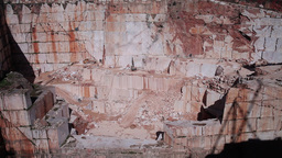 marble stone walls of old quarry with birds passing by Footage