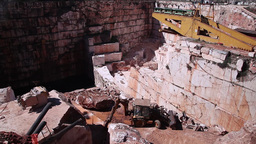workers working in marble stone quarry with backhoe loader Footage