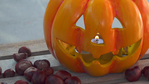 Halloween Pumpkin with Chestnuts Decoration on wooden box Footage