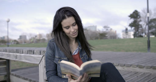 Woman reading outdoors – 4K Footage