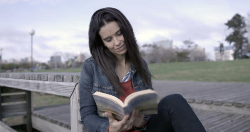 Woman reading outdoors – 4K Stock Video Footage