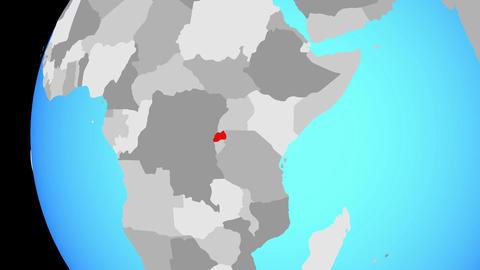 Closing in on Rwanda on blue globe Animation