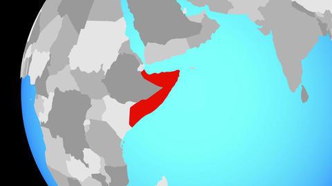 Closing in on Somalia on blue globe Animation
