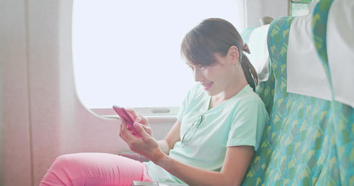 woman use phone in train ビデオ