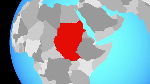 Closing in on Sudan on blue globe Animation