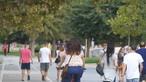 Pedestrians Walk and Cycle On The Sidewalk Archivo