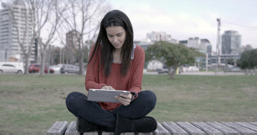 Woman with Ipad outdoors – 4k Footage