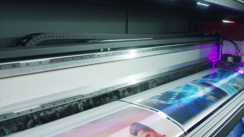 Large format printer printing high quality graphics at high speed Live Action