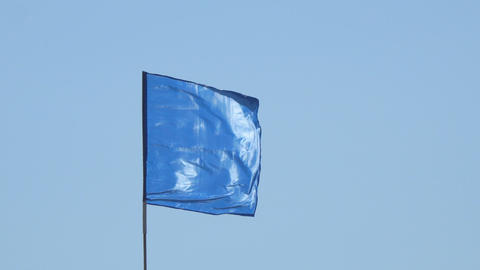 Blue flag on blue sky background Footage