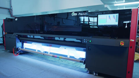 Large format printer printing high quality graphics at…, Live Action