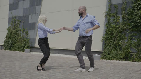 Young skillful business couple dancing latino frestyle... Stock Video Footage