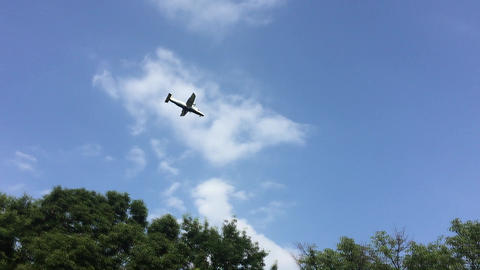 Light aircraft crossing the blue sky Live Action