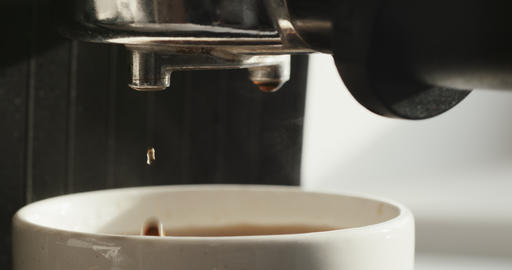 Flow of fresh coffee from the espresso machine horn ビデオ