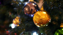 Yellow New Year Christmas ornament ball on Christmas Tree Footage