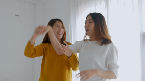 Young asian female lesbian couple dancing at bedroom.... Stock Video Footage