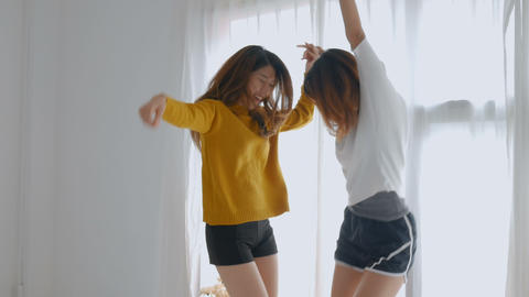 Young asian female lesbian couple dancing at bedroom. Lifestyle friendship Footage