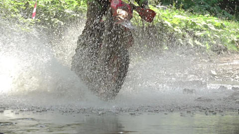 Enduro and a lot of Spray in the Sunshine. Slow Motion Live Action