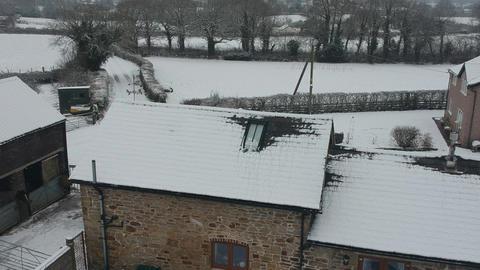 Ascending aerial footage snow rural uk Live Action