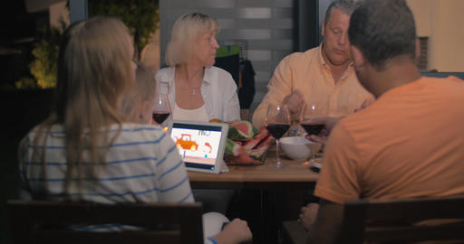 Friendly family having late outdoor dinner Footage