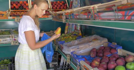 Choosing fruit in market Live Action