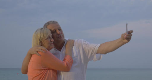 Senior couple making vacation selfie on mobile Footage
