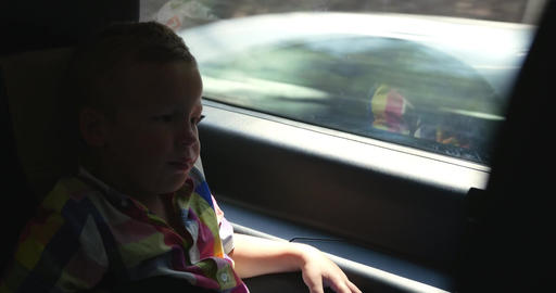 Little child traveling by car and yawning Footage