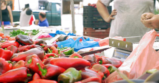 Buying red peppers on street market Footage