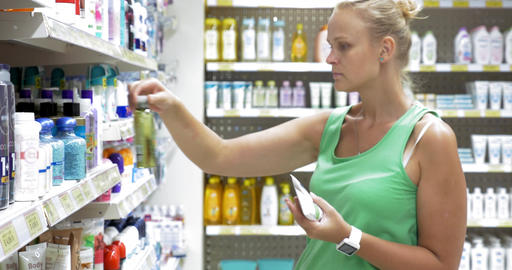 Woman choosing goods in beauty care section of store Footage