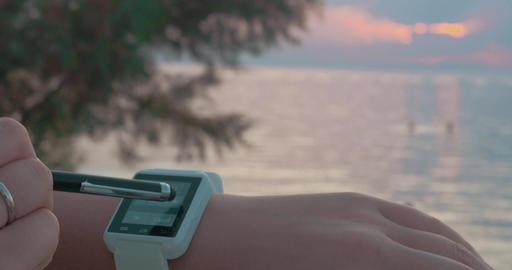 Using Smart Watch on the Beach Footage