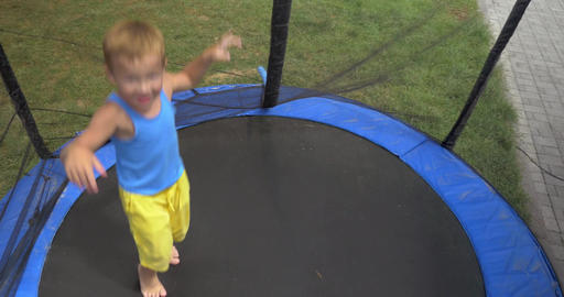 Child jumping inside protected outdoor tramp Footage