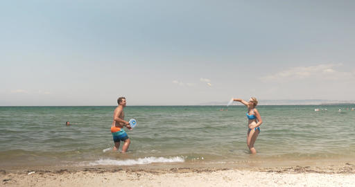 Young people enjoying tennis in the sea Footage