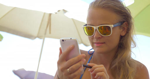 Close-up of blonde woman using smartphone Footage