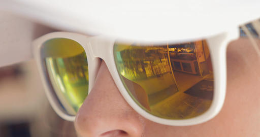 Close-up of woman wearing mirrored sunglasses Live Action