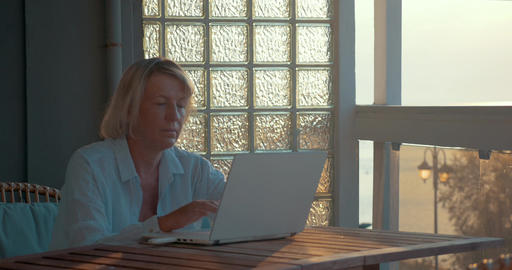 Woman using laptop and mobile internet device Footage