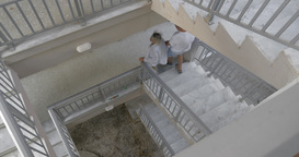 Couple Walking Down the Spiral Stairs Live Action