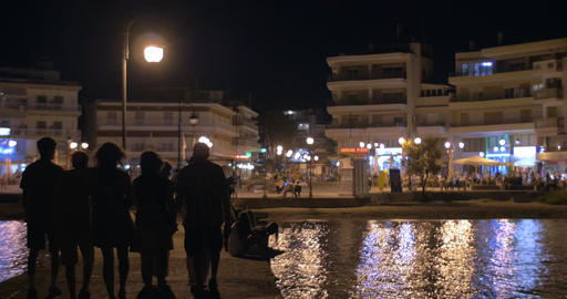 Pier and city square with people at night Footage